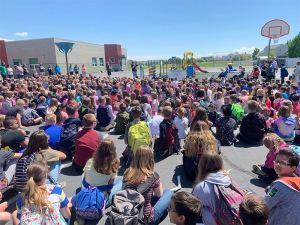 Students gather for the dedication of a new playground