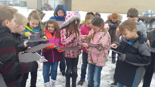 While learning about precipitation, Midland Students verify that snowflakes have six sides
