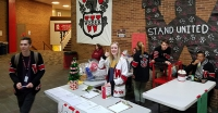Weber Warriors raise money for charity, assist families with Quarter and Cans fundraiser