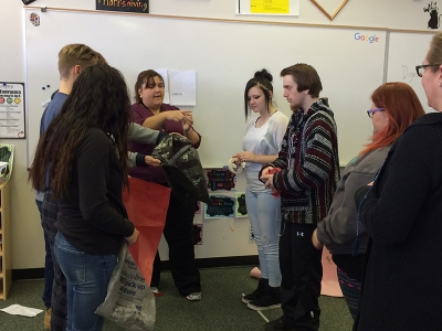 Canyon View High School students participate in a hands on learning activity about human anatomy