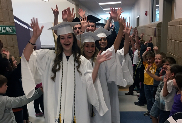 Former West Haven students come together for West Haven's Graduation Walk. One Town, One Team, One Dream. Everyone Graduates!