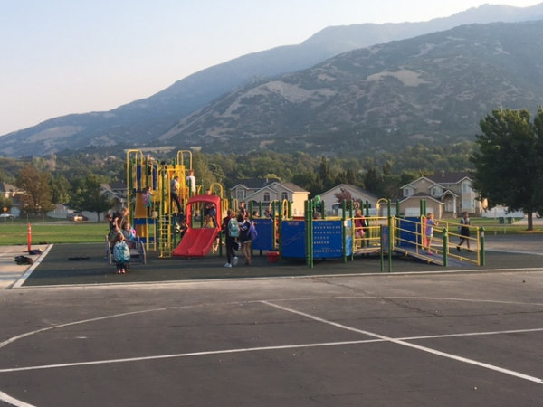 Children play on the New all accessible playground at Uintah!