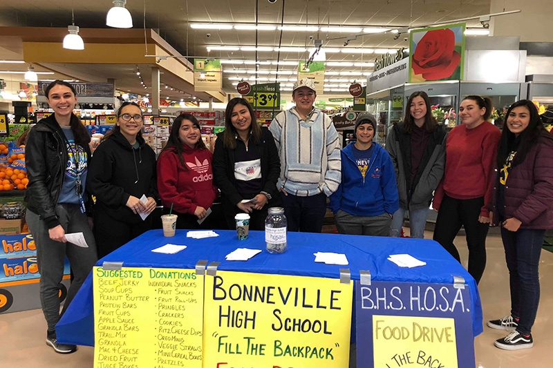 Bonneville students working at donation table