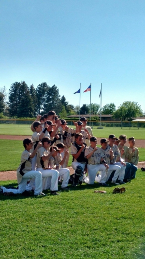 Sand Ridge wins the district baseball championship after an undefeated season