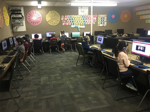 Students work on the APPL test (Chinese Immersion Test) at Uintah Elementary