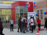 Excited students enter Orchard Springs Elementary for their big first day