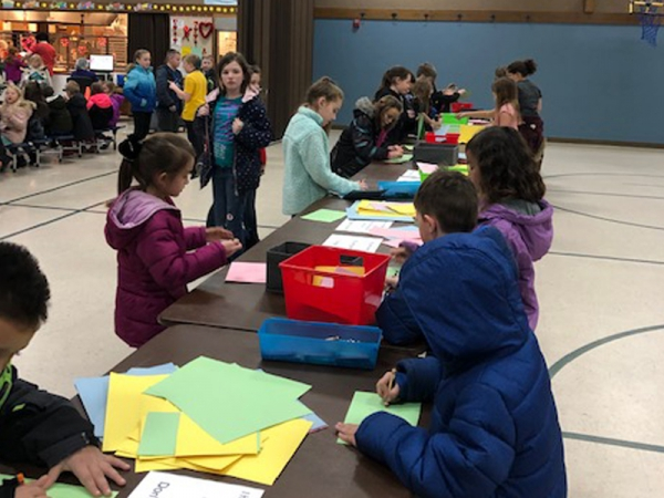Midland Elementary students take time at lunch to create encouraging notes for residents in a local assisting living care center