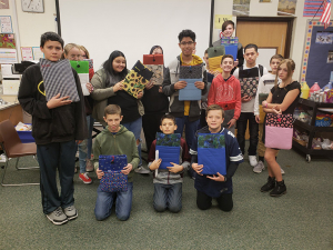 T.H. Bell students worked hard sewing chrome books covers