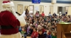 Santa reading Christmas stories at the new Burch Creek Elementary