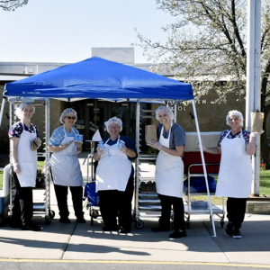 Child Nutrition Employees Prepare Sack Lunches