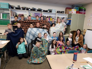Mrs. Burlison's 4th grade class at Majestic made blankets for kids in need