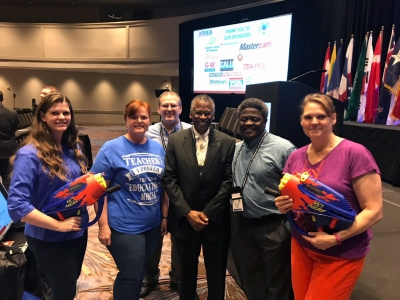 Weber School District Educators, pose for a picture with Lonnie Johnson, who is a former NASA engineer and inventor of the massively popular Super Soaker water gun at the the ITEEA conference.