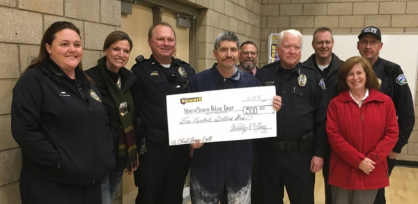 North Ogden Jr. donates money to the north ogden police department