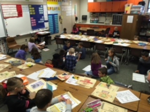 Grades 1 and 4 work together in cross age tutoring at Midland Elementary