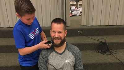 Mr. Lott at Majestic sacrifices his beard to raise money for his school's PTA.