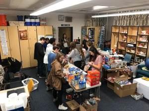 Students put together food packs.